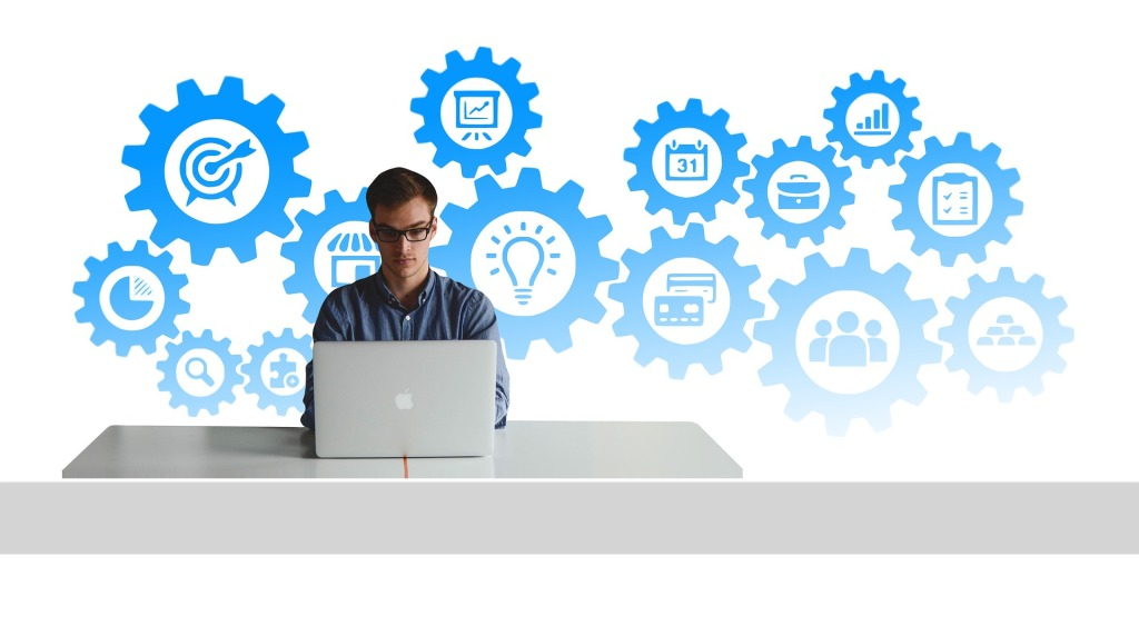 millennial man working at a Macintosh laptop with images of tasks in the background
